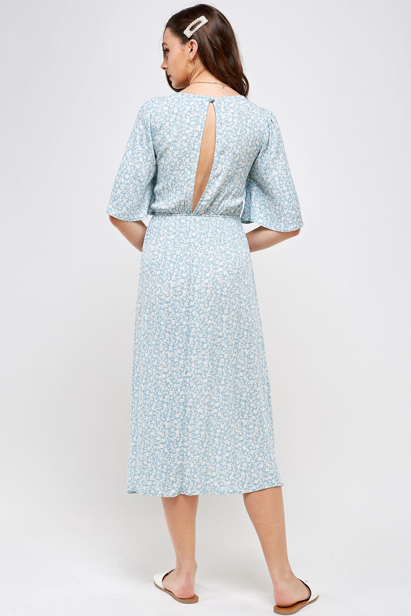 100% Rayon Tie Front Detail With Key Hole Elastic Waistband Open Back With Button Closure Back View